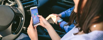 Girl and boyfriend using mobile in the car royalty free stock image