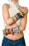 Girl with bracelets Stock Images