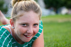 Girl with braces. An adolescent girl with braces on laughing in a grassy field Stock Images