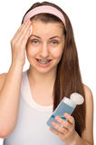Girl with braces cleaning face isolated Stock Images