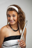 Girl with braces holding flute. Pretty young teen girl with braces smiling and holding a flute Royalty Free Stock Images