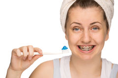 Girl with braces holding toothbrush isolated Stock Photos