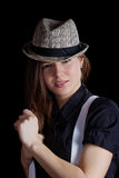 Girl with braces and  man's hat Stock Photography