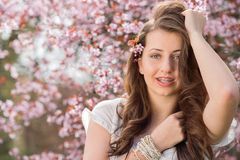 Girl with braces posing near blossoming tree Stock Photography