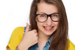 Girl with braces show thumb up isolated Royalty Free Stock Images