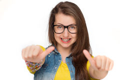 Girl in braces showing thumbs up isolated Stock Photography