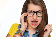 Girl in braces wearing geek glasses isolated Royalty Free Stock Photos