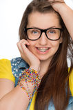 Girl with braces wearing geek glasses isolated Stock Photo