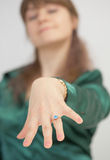 Girl brags of new ring with blue stone Stock Photography
