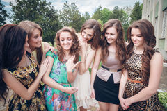 Girl brags to girlfriends of a ring Stock Photo