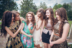Girl brags to girlfriends of a ring Stock Images