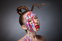 Girl with braid and artistic makeup over dark background Royalty Free Stock Photo