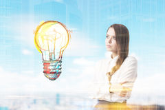 Girl with braided hair and light bulb in city Stock Photo