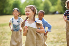 Girl with braided hair at sack race Royalty Free Stock Photo