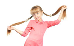 Girl with braids. Little girl holding her long braids on white background Royalty Free Stock Images