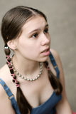 Girl with braids. Shallow DOF Royalty Free Stock Photo