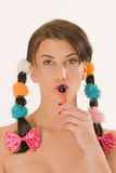 Girl with braids and colorful lollipops Stock Photos