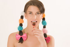 Girl with braids and colorful lollipops Royalty Free Stock Photography