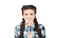 Girl with braids and lollipop. Stock Photos