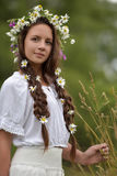 Girl with braids and a wreath of daisies. Girl with braids and daisies in her hair Stock Images
