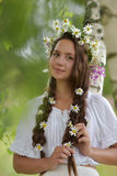 Girl with braids and a wreath of daisies. Girl with braids and daisies in her hair Royalty Free Stock Photos