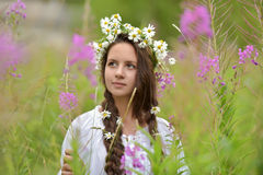 Girl with braids and a wreath of daisies Royalty Free Stock Photos