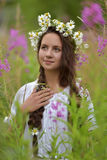 Girl with braids and a wreath of daisies. Girl with braids and daisies in her hair Stock Photography