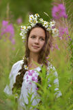 Girl with braids and a wreath of daisies Stock Photography