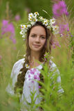 Girl with braids and a wreath of daisies. Girl with braids and daisies in her hair Stock Photo