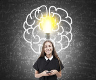 Girl and brain and lightbulb sketch on chalkboard Royalty Free Stock Image