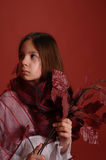 Girl with a branch of autumn leaves Royalty Free Stock Image
