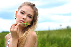 Girl with a branch of berries in your hand Stock Images
