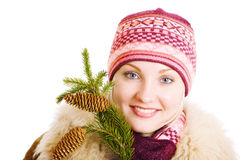 Girl with a branch of fur tree Royalty Free Stock Photography