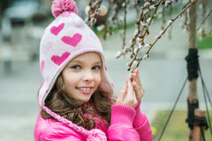 Girl with a branch of willow Stock Photos