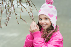 Girl with a branch of willow Stock Image