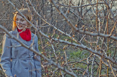 Girl between the branches Royalty Free Stock Images