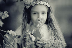 Girl in  branches of lilac. Girl in the branches of lilac Stock Images