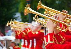 Girl Brass Band. In red uniform performing Royalty Free Stock Photo