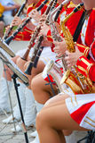 Girl Brass Band. In red uniform performing Royalty Free Stock Images