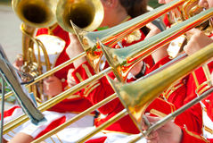 Girl Brass Band. In red uniform performing Royalty Free Stock Image