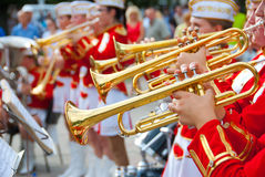 Girl Brass Band. In red uniform performing Stock Image