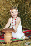 The girl with bread Stock Images