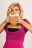 Girl with bread Stock Photography