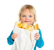 Girl with bread Stock Images