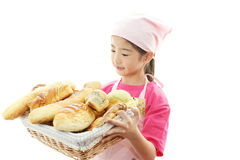 Girl with bread. Beautiful Asian girl with bread on a white background royalty free stock image