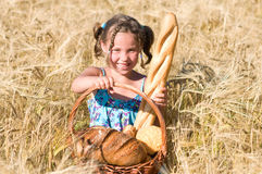 Girl with bread in cornfield Royalty Free Stock Images