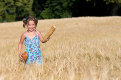 Girl with bread in the cornfield Royalty Free Stock Photography