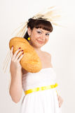 Girl with bread and ears of wheat Royalty Free Stock Image