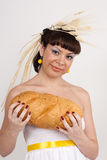 Girl with bread and ears of wheat Stock Photos