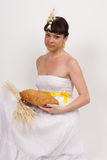 Girl with bread and ears of wheat Royalty Free Stock Photography